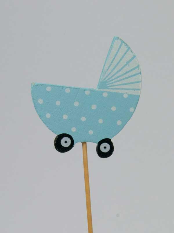 Leuke bijsteker voor bij een geboortegeschenk: Een houten wiegje op stok.