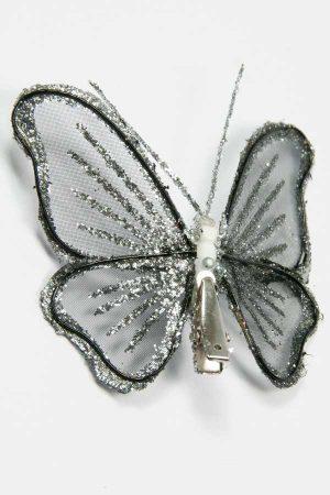 achterzijde van de zilverglitter vlinder met clip goed zichtbaar
